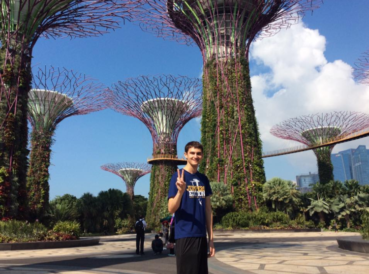 Ku Thomas stands in gardens in Singapore