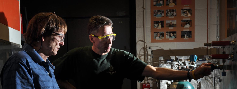 Faculty member John Falconer works in his research lab.