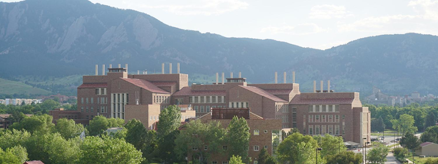 The chem-bio building in the distance against the mountains