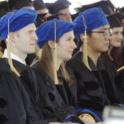 PhD candidates at graduation ceremony.