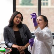 Anushree Chatterjee and graduate student in the lab looking at a petri dish