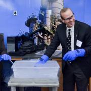 Cynthia Murphy and Mike Wirth of Chevron use liquid nitrogen to freeze tubing