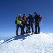 The Colorado Buffaloes atop snowy Denali.