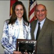 Frannie Ray Earle receives award from chancellor Phil DiStefano.