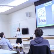 A graduate student presents her research