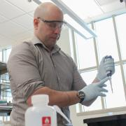 Timothy Whitehead working in his lab.