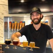 Jason Slingsby serves up beer at his brewery