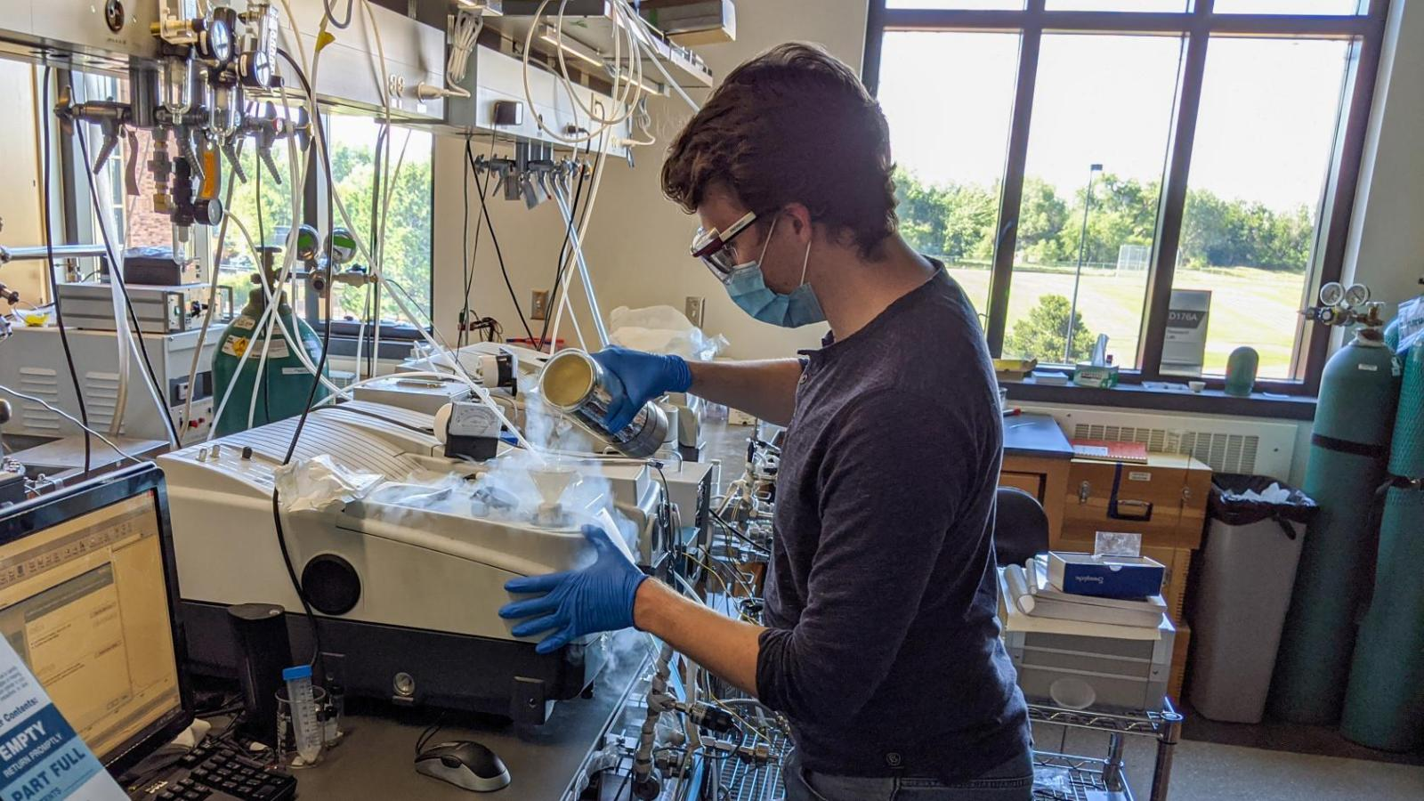 Alex Jenkins working in the Medlin Lab with PPE