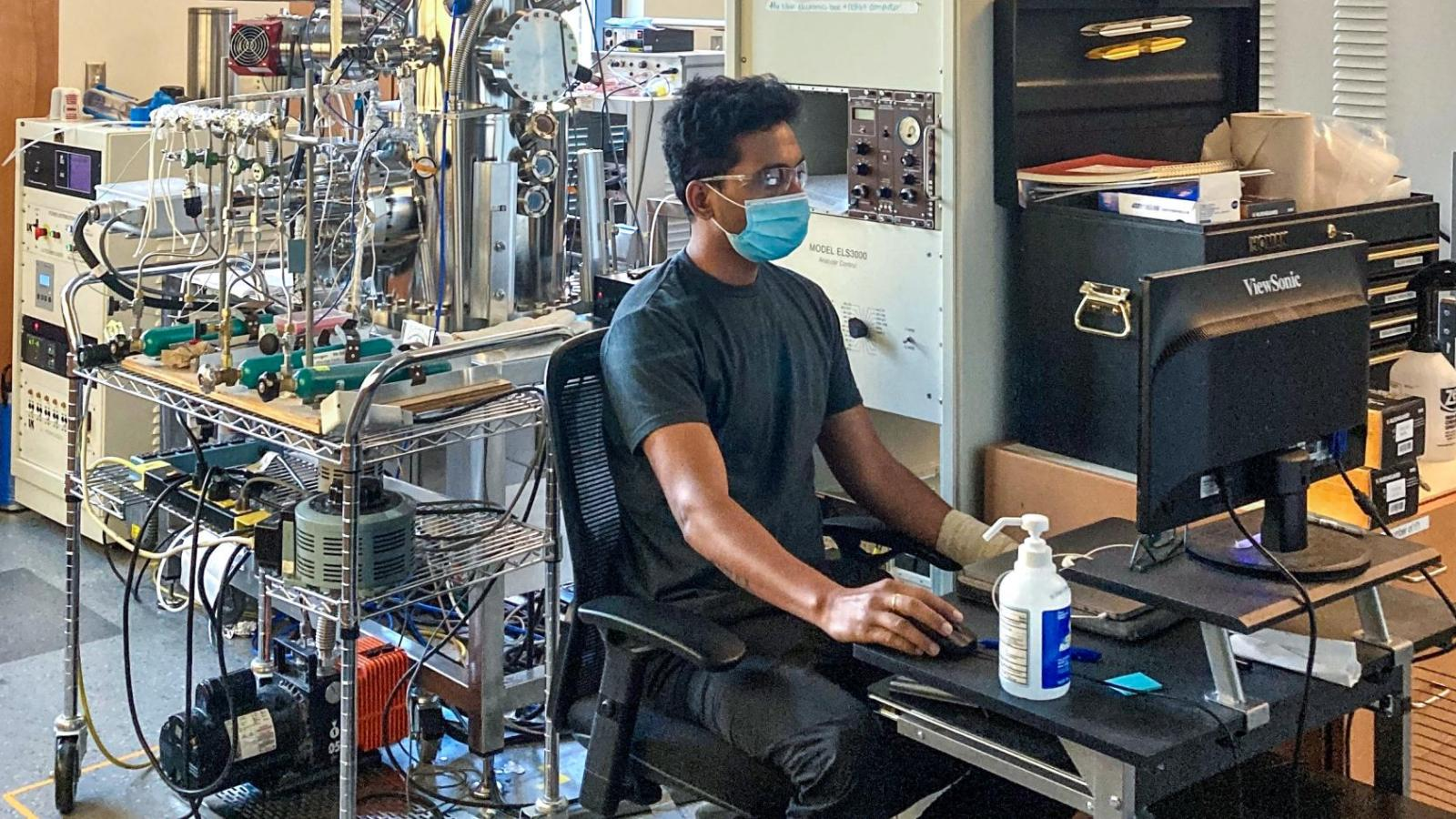 Ashutosh Mishra working in the Medlin Lab with PPE