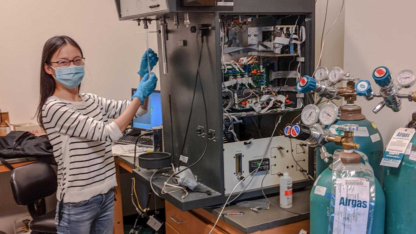 Xinpei Zhou wearing PPE while working in the Medlin Lab