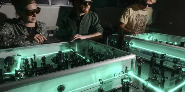 Graduate students in laser lab