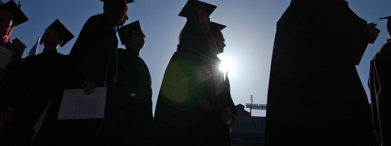 outline of grads walking