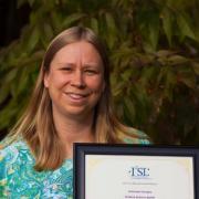 Kathy Ramirez-Aguilar holding I2SL Award