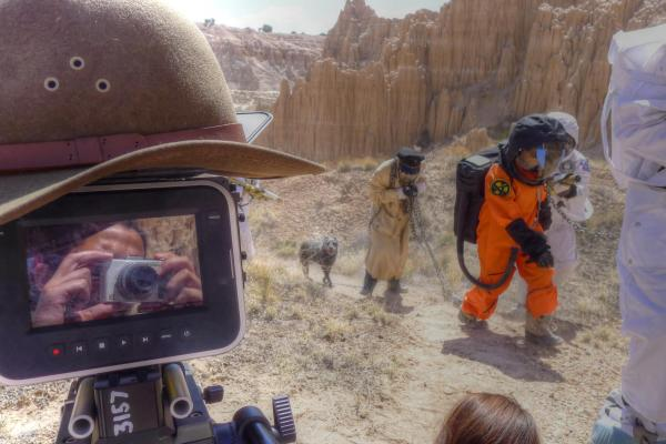 FIlm set in the desert, dressed as astronauts