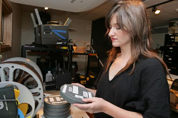 Student Employee working with film canisters