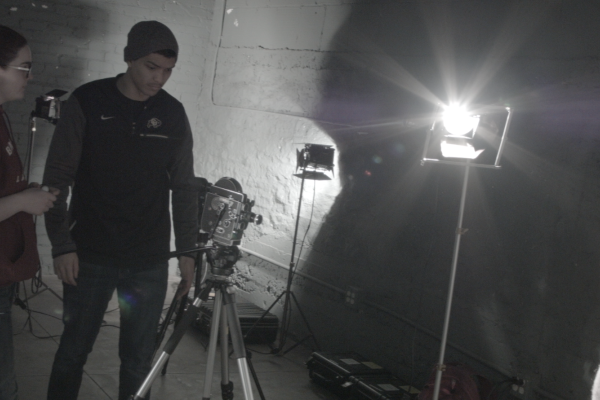 Students working on lighting a set