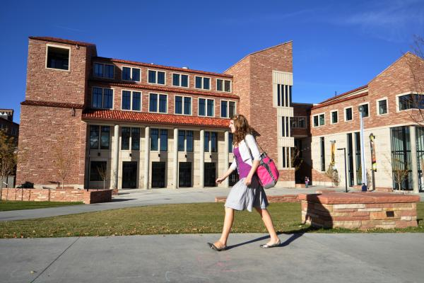 Student walking on CU Boulder's campus