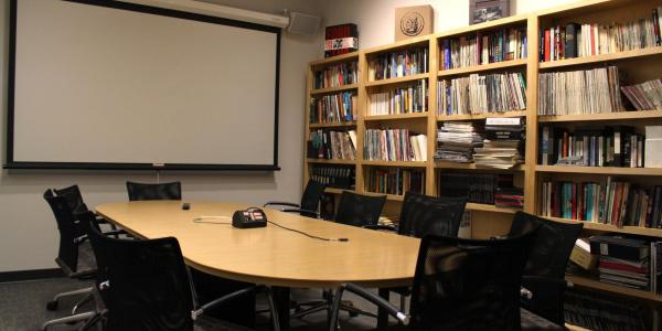 conference room with full bookshelves
