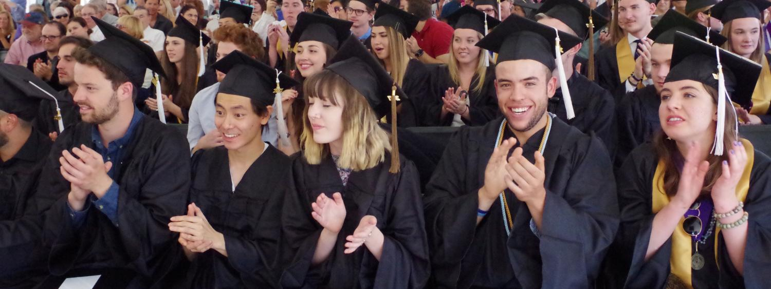 Graduating students clapping