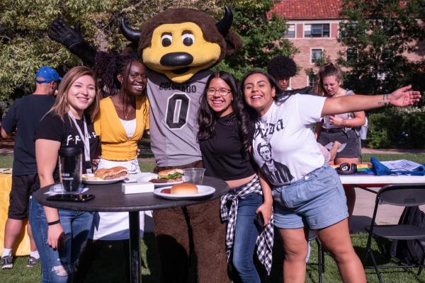 Students at CUnity Fest with Chip, CU Boulder's mascot