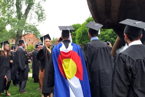 Graduate wearing Colorado flag cape