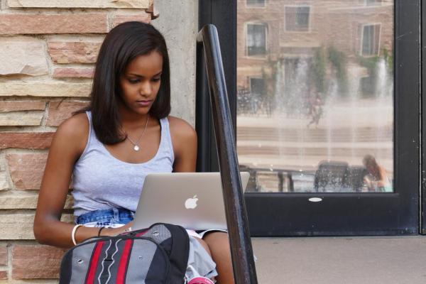 student studying on steps near UMC
