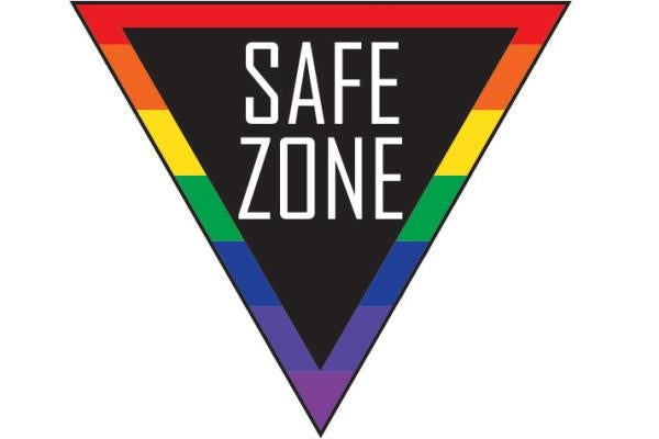 """image of a triangular road sign with a rainbow border that reads """"Safe zone"""""""