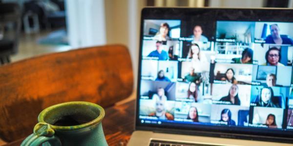 coffee mug and Computer with zoom call