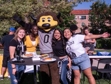 Students with Chip, the mascot, at CUnity Fest on campus