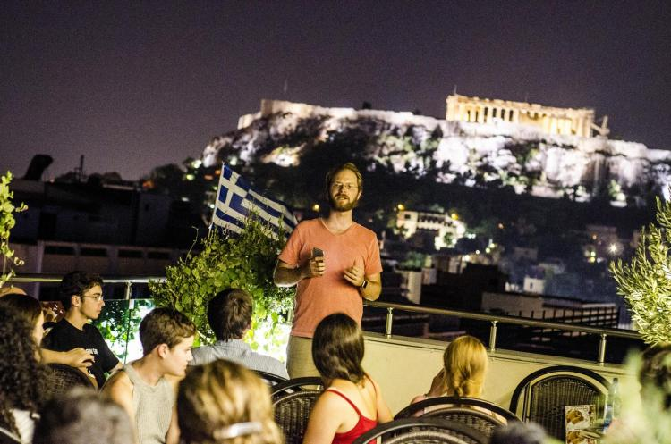 Jason Pedicone speaking to a group of students in Greece