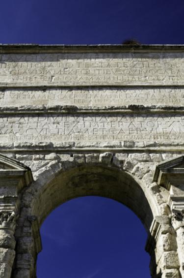 An ancient arch with Latin inscriptions