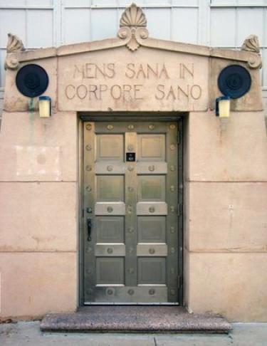 Latin text written over a doorway