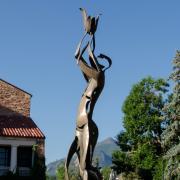 Statue of person holding fire aloft