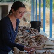 Sarah James at work on pottery at Corinth