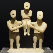 cycladic sculpture group of three figures, Smial, CC BY-SA 2.5 <https://creativecommons.org/licenses/by-sa/2.5>, via Wikimedia Commons