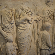 fragment of the ara pacis, Following Hadrian, CC BY-SA 2.0 <https://creativecommons.org/licenses/by-sa/2.0>, via Wikimedia Commons