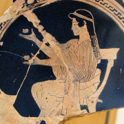 seated girl juggling on the side of a potsherd, Regional Archaeological Museum Antonino Salinas, CC BY 2.5 <https://creativecommons.org/licenses/by/2.5>, via Wikimedia Commons