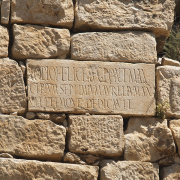 latin inscription on a block in tunisia, Graham Claytor / Institute for the Study of the Ancient World, CC BY 2.0 <https://creativecommons.org/licenses/by/2.0>, via Wikimedia Commons