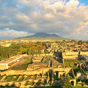 ruins of pompeii with vesuvius in the background, ElfQrin, CC BY-SA 4.0 <https://creativecommons.org/licenses/by-sa/4.0>, via Wikimedia Commons