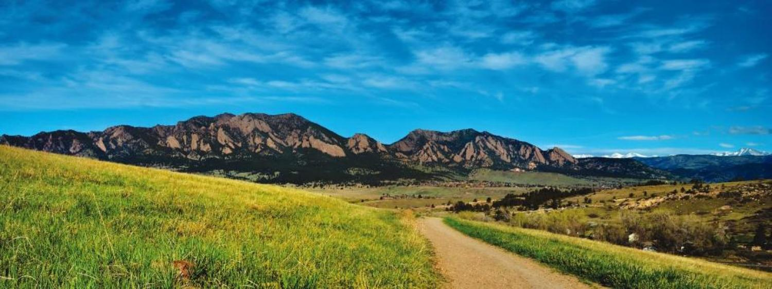 Scenic view of trail leading to flatiron mountians