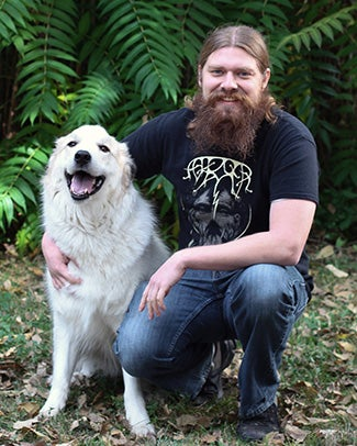 Tyler Rollins and his dog
