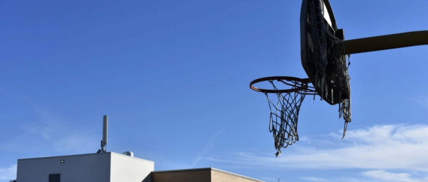 A basketball hoop at Castro Elementary School, in the Westwood neighborhood of Denver. (Jackson Reed, Special to The Colorado Sun)