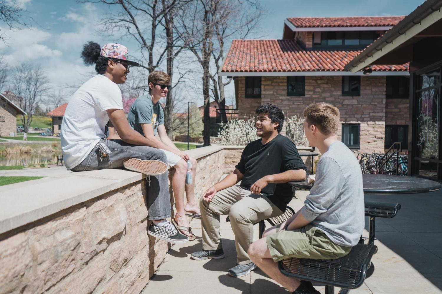 A group of students talking on the CU Boulder campus