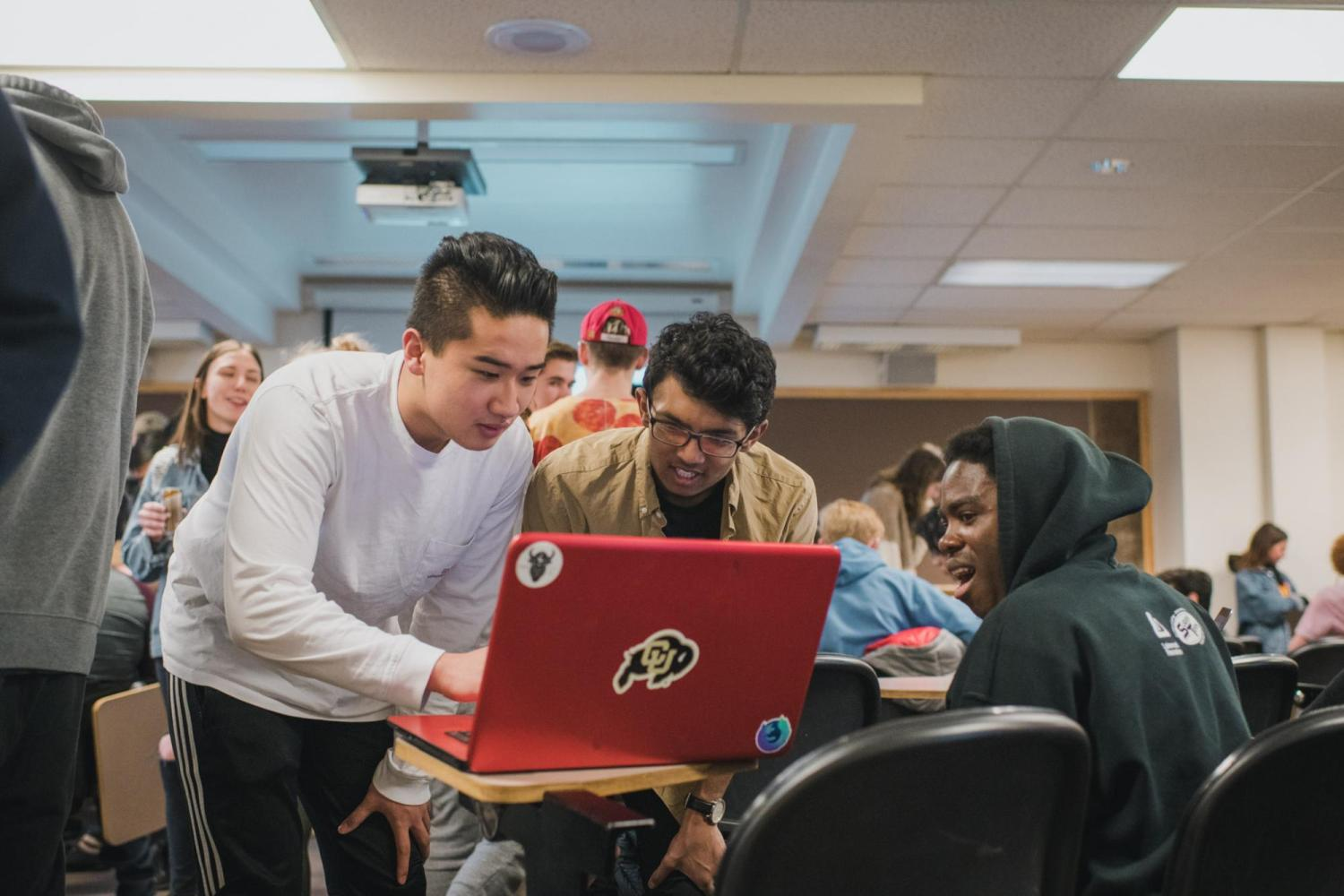 A group of students working together on a computer