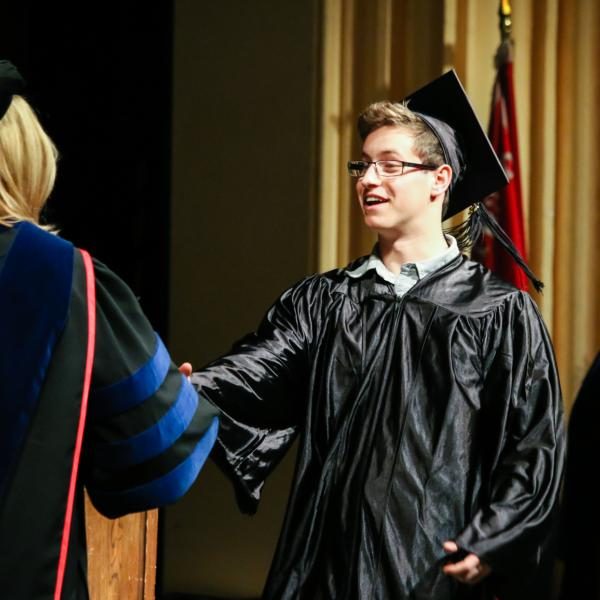 Receiving his degrees