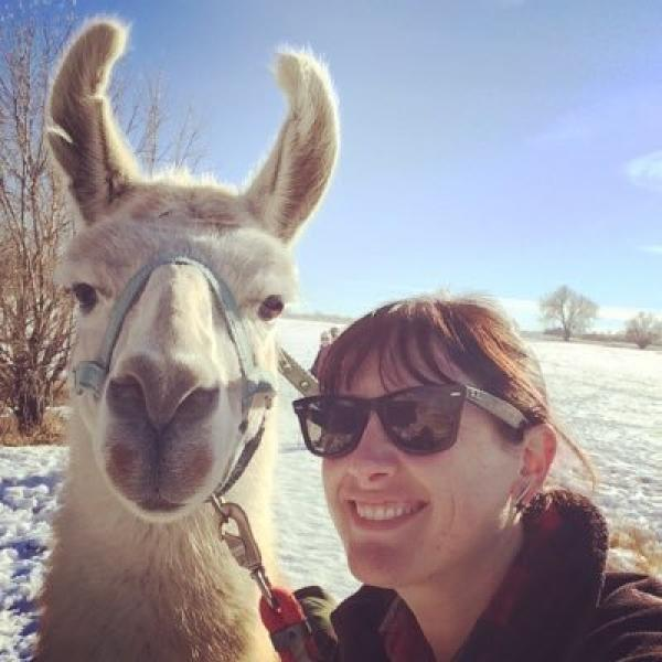 Lindsay Diamond poses with a llama.