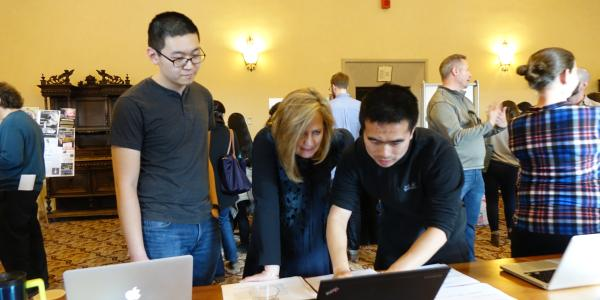 Graduate students gathered with peers, staff and faculty members Friday to share research projects during the graduate research and creative practice fair in Norlin Library.
