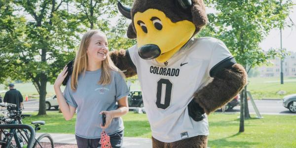 Student with Ralphie mascot