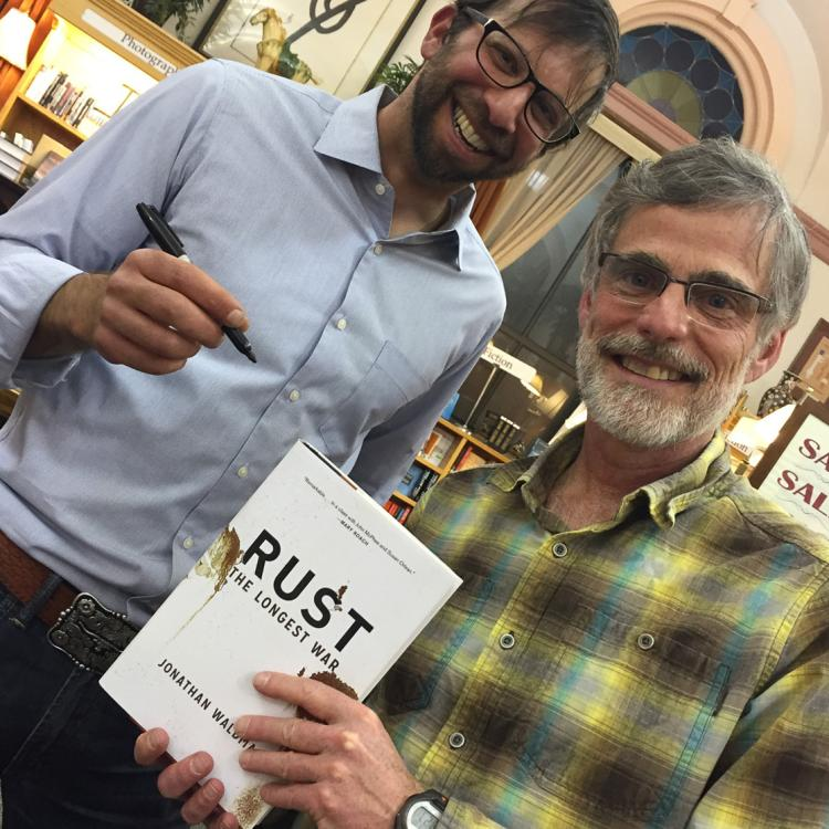 Waldman and Yulsman pose at a book signing.