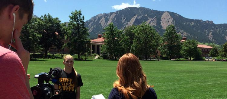 Journalism Students Interviewing Student In Front of Flatirons